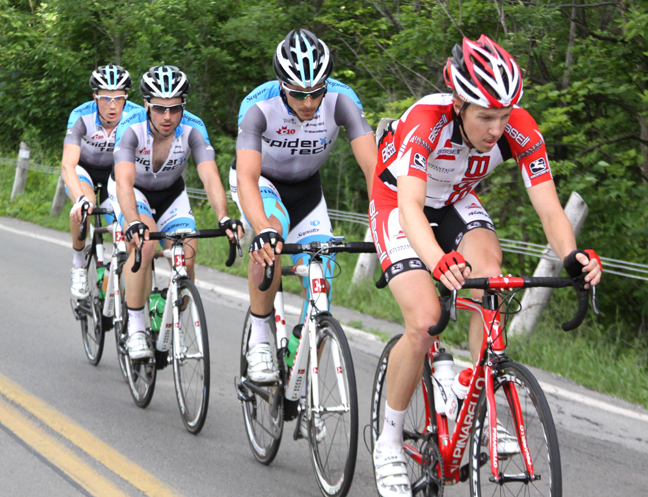 Rob Britton (Bissell Pro Cycling) at the front of the break with SpiderTech riders in tow.[P]Chris Redden