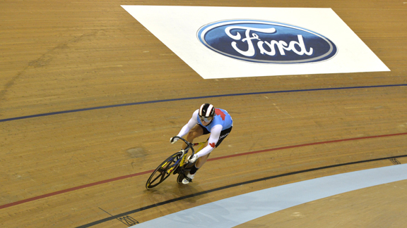 Hugo Barrette hammers on the track to finish 7th in the men's Keirin  ©  Guy Swarbrick