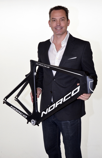 Mark Ernsting with team specific Norco Time Trial frame. [P] courtesy of M1 Pro Cycling Project