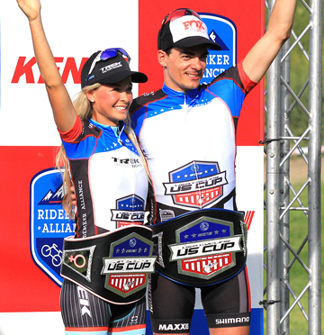 Emily Batty (Trek Factory Racing)  and Raphael Gagne (Rocky Mountain) with their US Cup leaders' belts and jerseys on the podium [P] Ridebiker Alliance