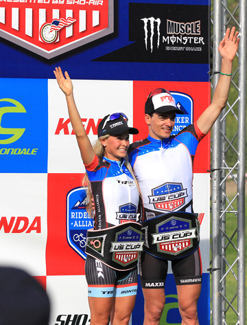 Emily Batty (Trek Factory Racing) and Raphael Gagne (Rocky Mountain Bicycles) with their US CUP leaders' belts on the podium at Bonelli Park, round 1 of the USA Cycling US CUP Series p/b Cannondale [P] courtesy of Sho-Air