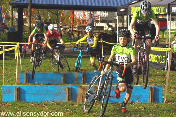 Cody Scott runs the barriers while Lief Rodgers and Nathan Bishop bunny hop behind.  ©  Alison Sydor