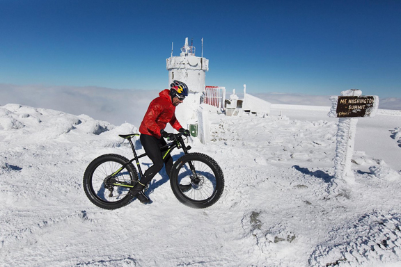 Tim Johnson climbs Mount Washington on his fat bike for the first winter ascent of the auto road on a bicycle on Mount Washington in Gorham, NH [P] Brian Nevins/Red Bull Content Pool