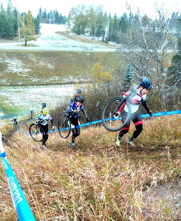 Provincial CX champion Shantel Koenig (Redbike) leading a trio up the slick run-up in the Open Women's race on Saturday. [P] Andrew Davidson